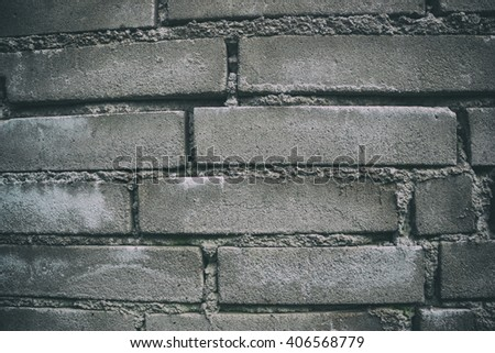Close up of old worn brick wall background. Aged dirty stone wall textured. Vintage effect  - stock photo