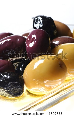 close up of olives isolated on white - stock photo