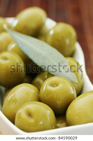 Close up of Olives on a wooden table ,shallow dof - stock photo
