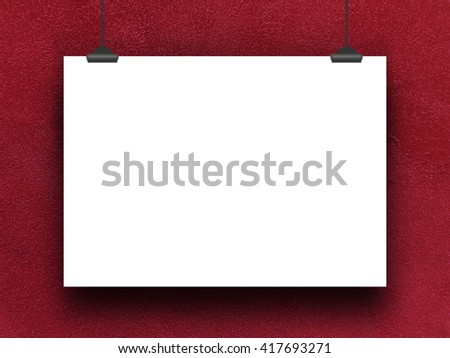 Close-up of one blank poster frame hanged by clips against red plastered concrete wall background