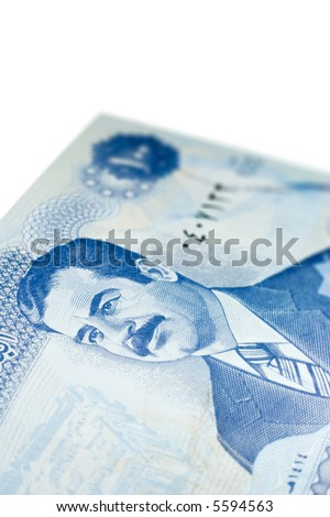 Close-up of one hundred Iraqi dinars banknote.  Features Saddam Hussein. - stock photo