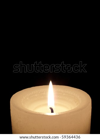 Close up of one lit white candle on black background. - stock photo