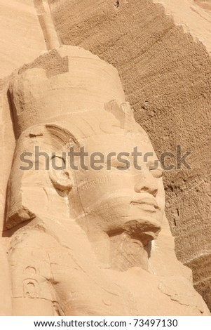 Close up of one of the colossal statues of Ramesses II, wearing the double crown of lower and upper Egypt, in Abu Simbel, Egypt - stock photo
