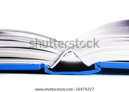 close up of open blue book isolated