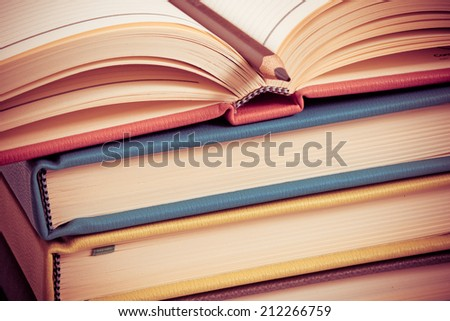 Close-up of open book and pen - stock photo