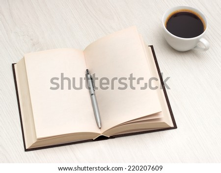 Close-up of open book and pen, coffe - stock photo