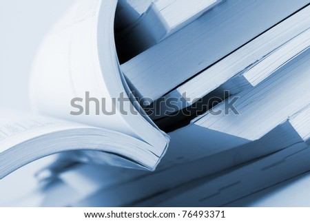 Close-up of open business catalog. Toned in blue - stock photo
