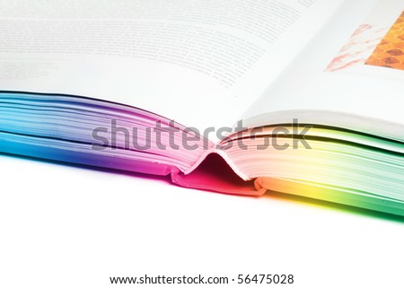 close up of open colorful book isolated