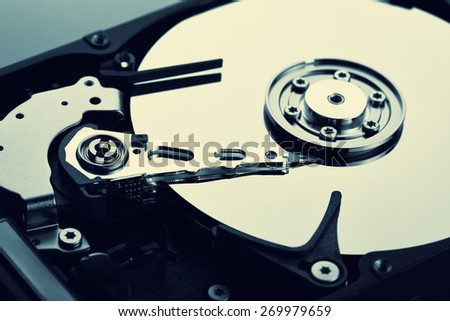 Close up of open computer hard disk drive (HDD) - stock photo