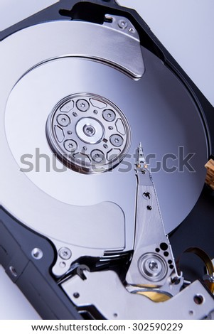 Close up of open computer hard disk drive HDD - stock photo