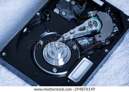 Close up of open computer hard disk drive (HDD). Inside harddisk - stock photo