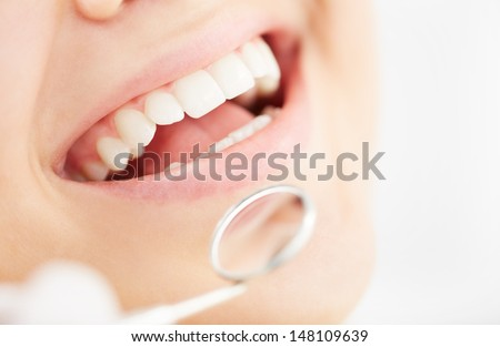 Close-up of open mouth during oral checkup at the dentist�¢??s