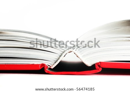 close up of open red book isolated