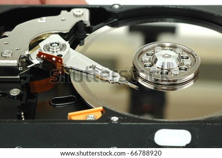 Close up of opened hard disk drive hard disc repairing concept , data saving concept - stock photo