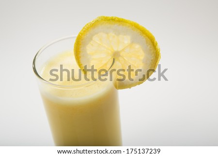 Close up of orange juice in a glass isolated on white background - stock photo