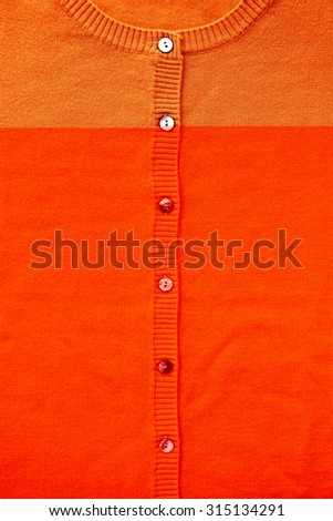 Close-up of orange round collar sweater. Attention: the thumbnail shows incorrect colors. The original image's color is correctly without problem. - stock photo