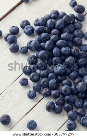 Close Up Of Organic Blueberries On White Table. Concept For Healthy Eating And Nutrition