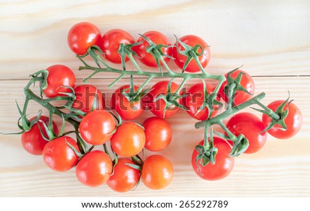 Close up of organic tomatoes on wooden background - stock photo