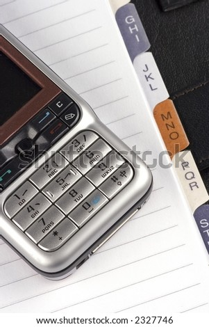 Close up of organizer with mobile phone. - stock photo