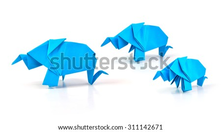 Close up of origami elephant family isolated on white background, selective focus.  - stock photo
