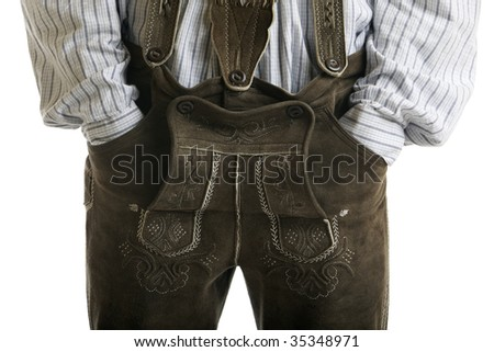 Close-up of original Oktoberfest Leather Trousers (Lederhose) worn by man with hands in pockets - stock photo