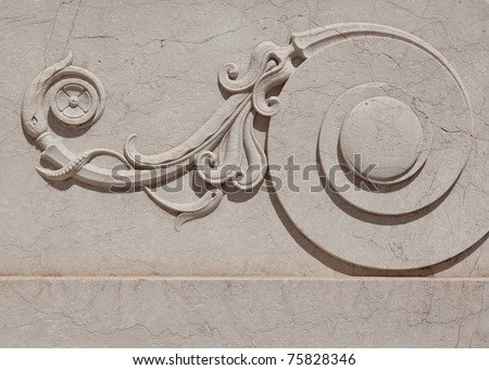 Close up of ornate scroll carved in marble. - stock photo