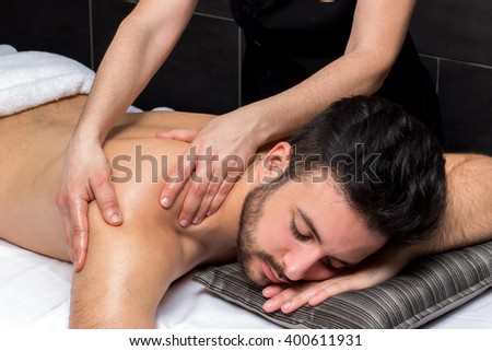 Close up of osteopath doing male back massage.