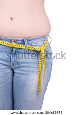 close up of overweight woman's belly and measure tape isolated on white background
