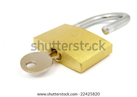 close up of padlock and key on white background with clipping path, shadow not included - stock photo