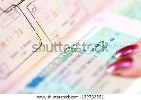 Close up of Page of passport witn Schengen visa