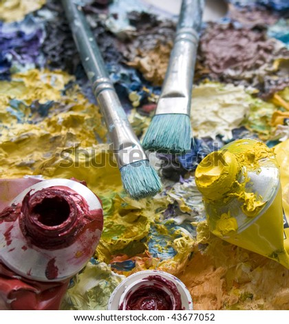 Close up of paint and paint brushes