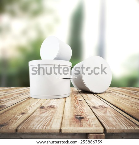 Close up of paint containers on the table - stock photo