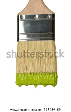 Close up of paintbrush dripping paint isolated over white background - stock photo