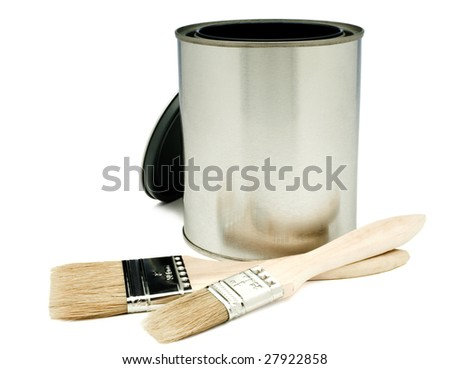 Close-up of paintbrush with a paint can isolated over white
