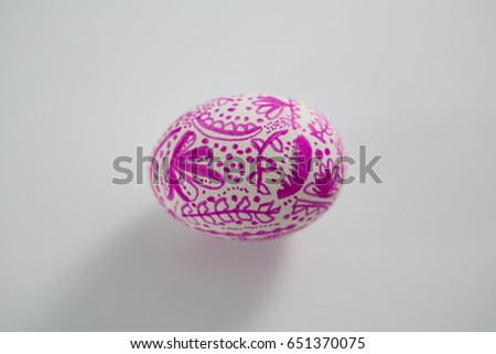 Close-up of painted Easter egg on white background