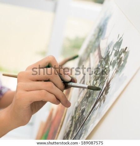 Close-up of painter doing a stroke - stock photo
