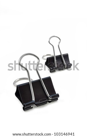 close up of pair of binder clips arranged on white background