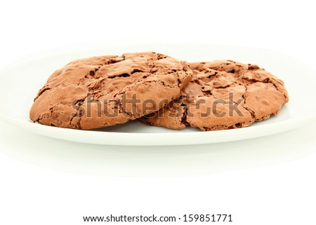 Close Up Of Pair Of Chocolate Chewy Cookies On White Plate - stock photo