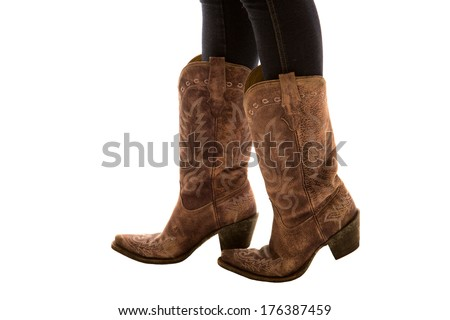 Close up of pair of cowboy boots - stock photo