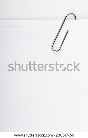 close up of paper clip holding some papers - stock photo