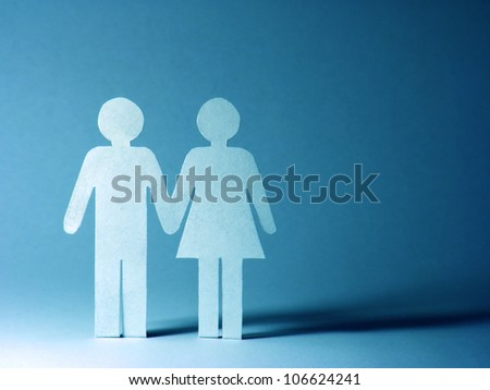 Close up of paper man and woman. - stock photo