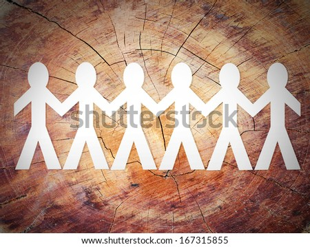 close up of paper people  on a wood - stock photo
