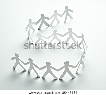 close up of  paper people on white background - stock photo