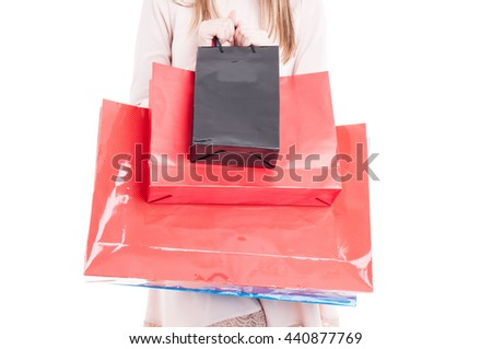 Close-up of paper shopping bags in young  shopper hand with copy space or text area isolated on white studio background - stock photo