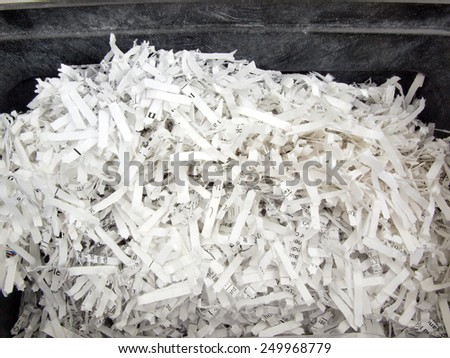 close up of paper that was shredded for confidentiality - stock photo