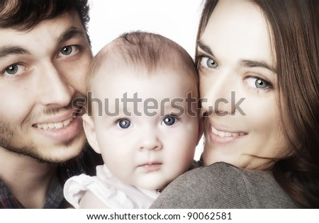 Close up of parents cuddling adorable baby.  Image isolated against white background - stock photo
