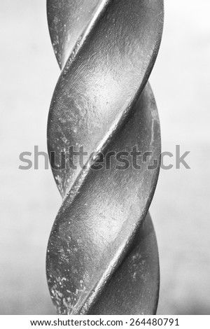 Close up of part of a metal spiral pole in black and white - stock photo