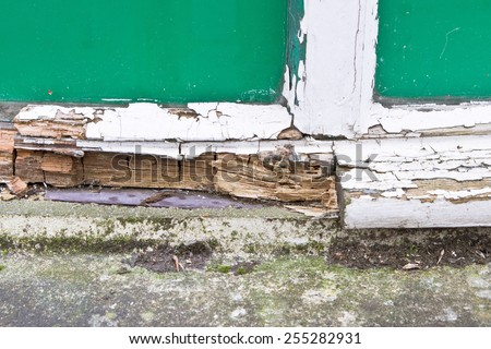 Close up of part of a wooden window frame showing extensive rot - stock photo