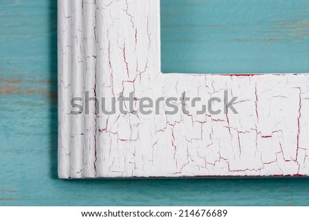 Close up of partial picture frame to show cracked paint detail. - stock photo