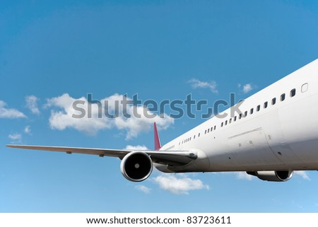 Close-up of passengers airplane flying in the sky - stock photo